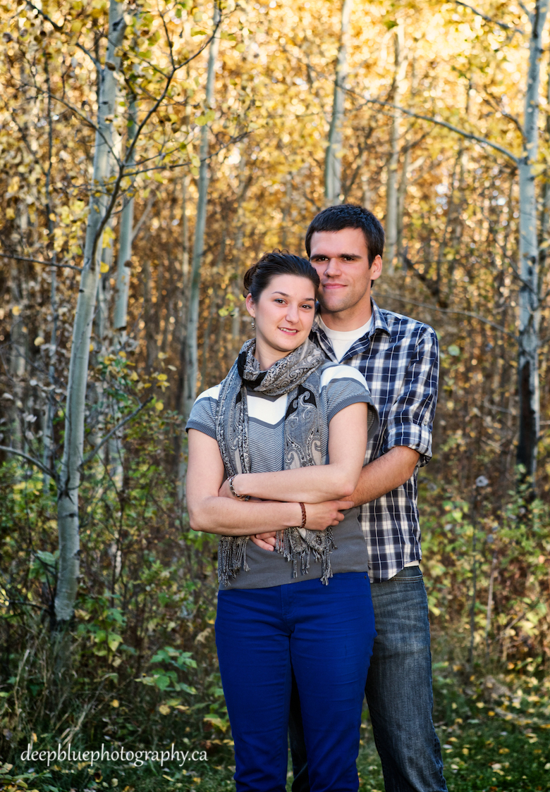 Chris with his arms around Natalie during their Blackfoot Trails Engagement Pictures.