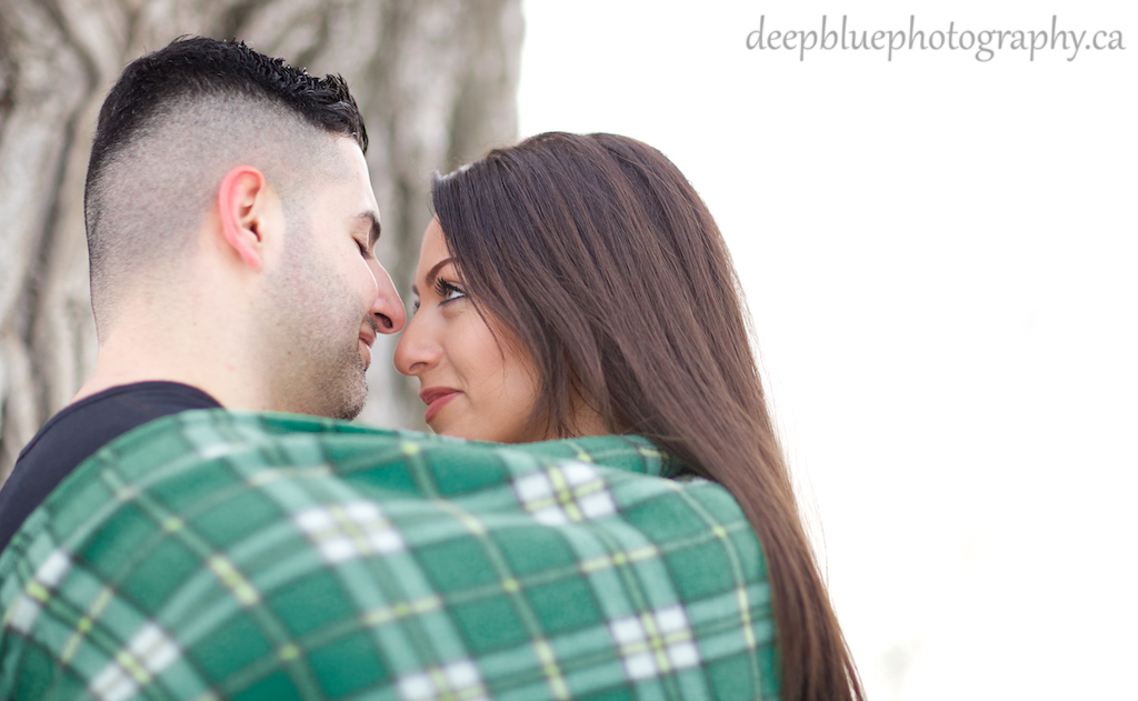 Photo of Couple Wrapped in Blanket
