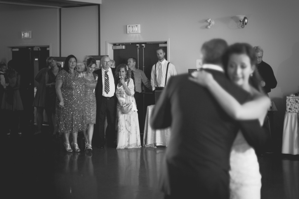 Black and white photo of bride dancing with father