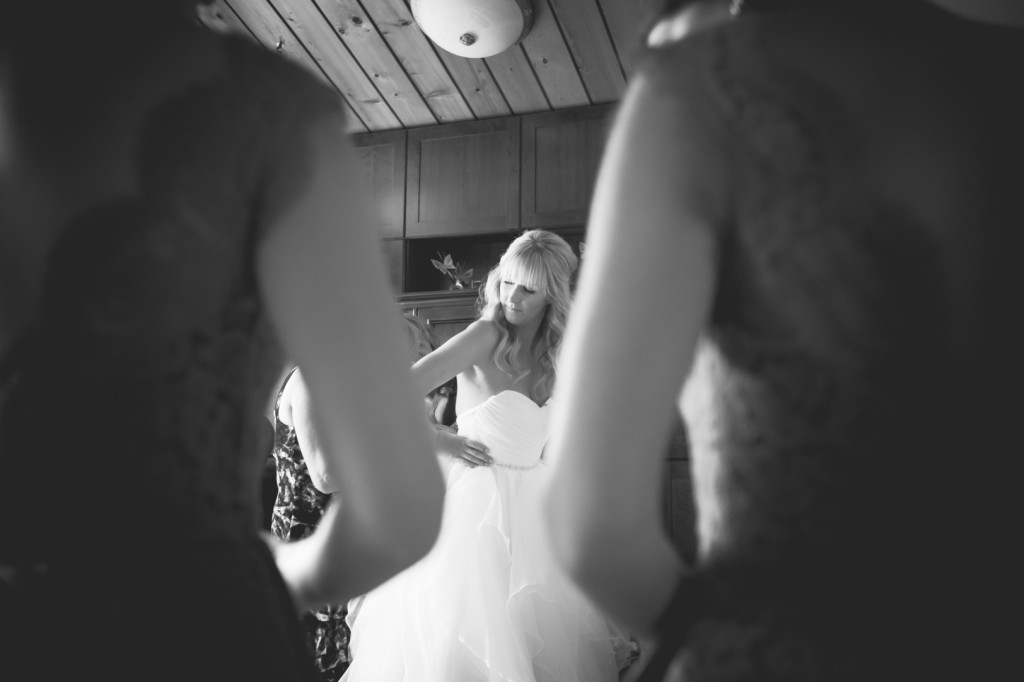 Bride Putting on Her Dress for Hastings Lake Wedding ceremony