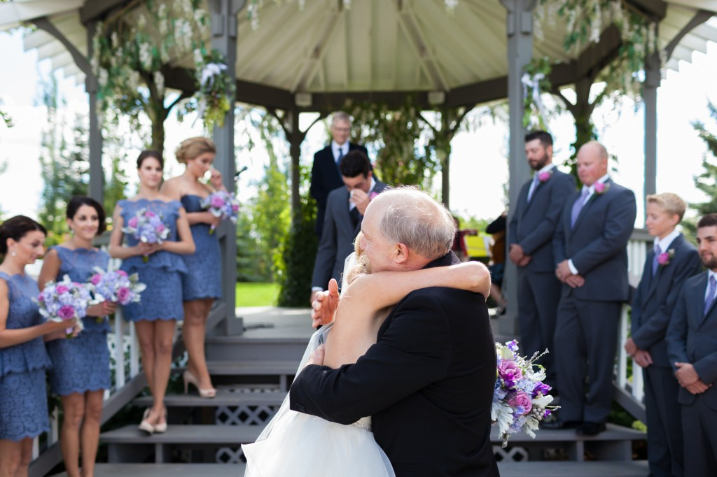 Father giving away bride at Hastings Lake Wedding