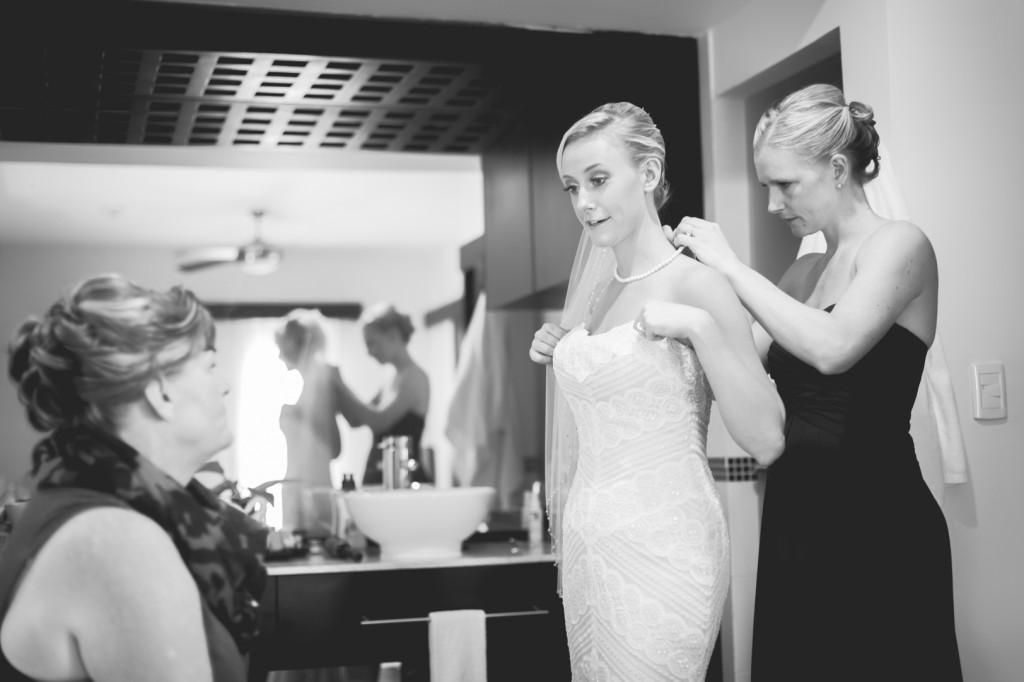 Photo of Bride Putting on Dress