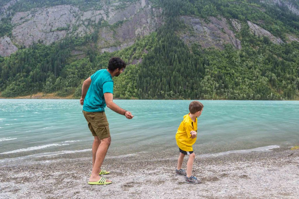 skipping rocks on a lake in the mountains