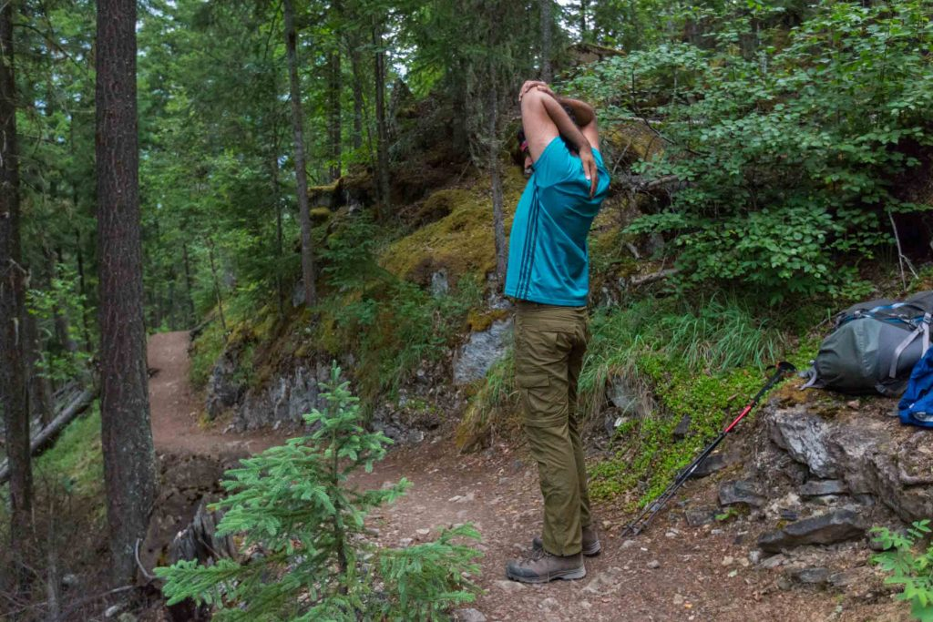 Tips for backpacking with kids - Stretching during breaks!