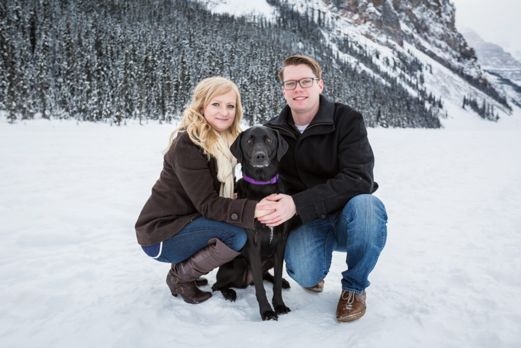 couple with their dog during mountain engagement session