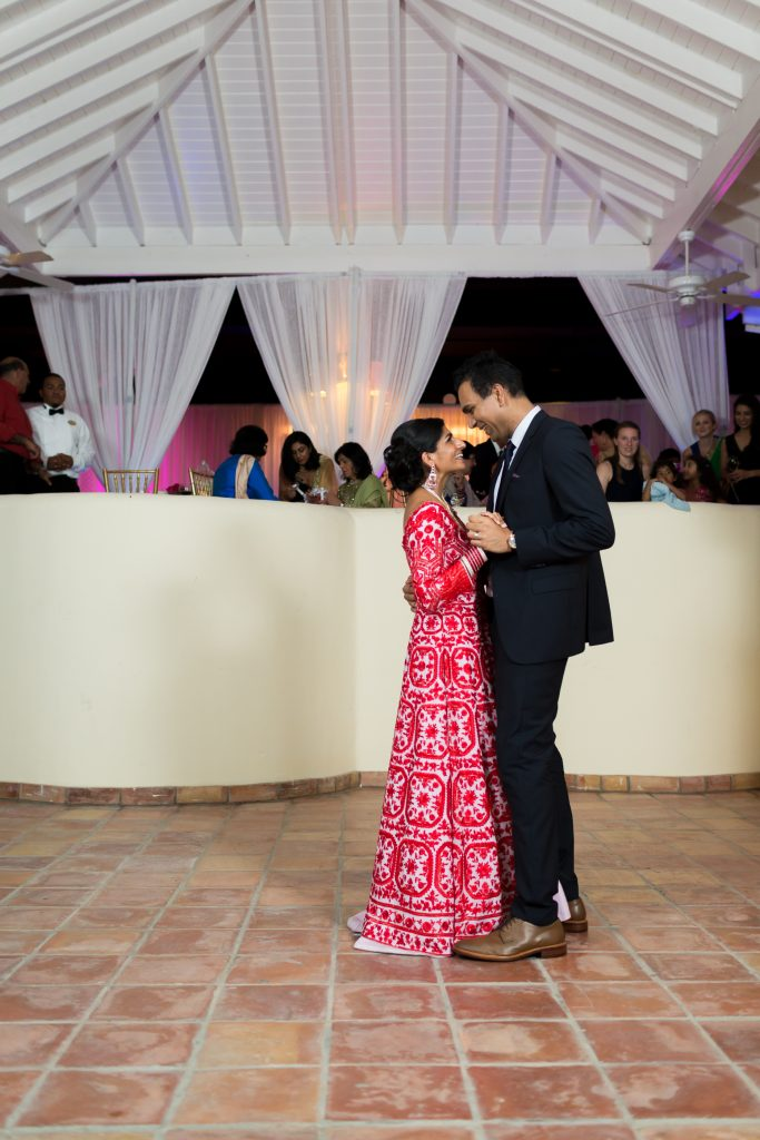 Bride and groom share their first dance in Antigua during their destination wedding reception