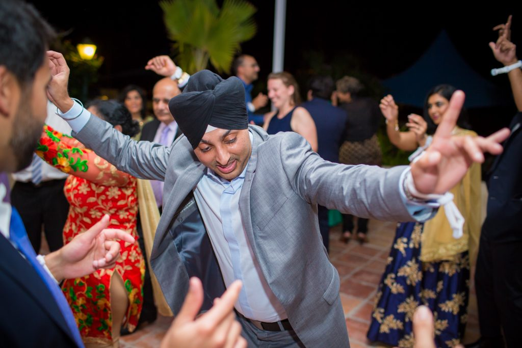 Guests dancing during Indian wedding reception at St James Club in Antigua