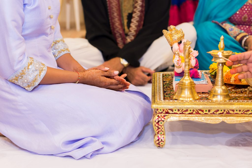 Photo of the bride to be sitting in preparation for the Choora ceremony