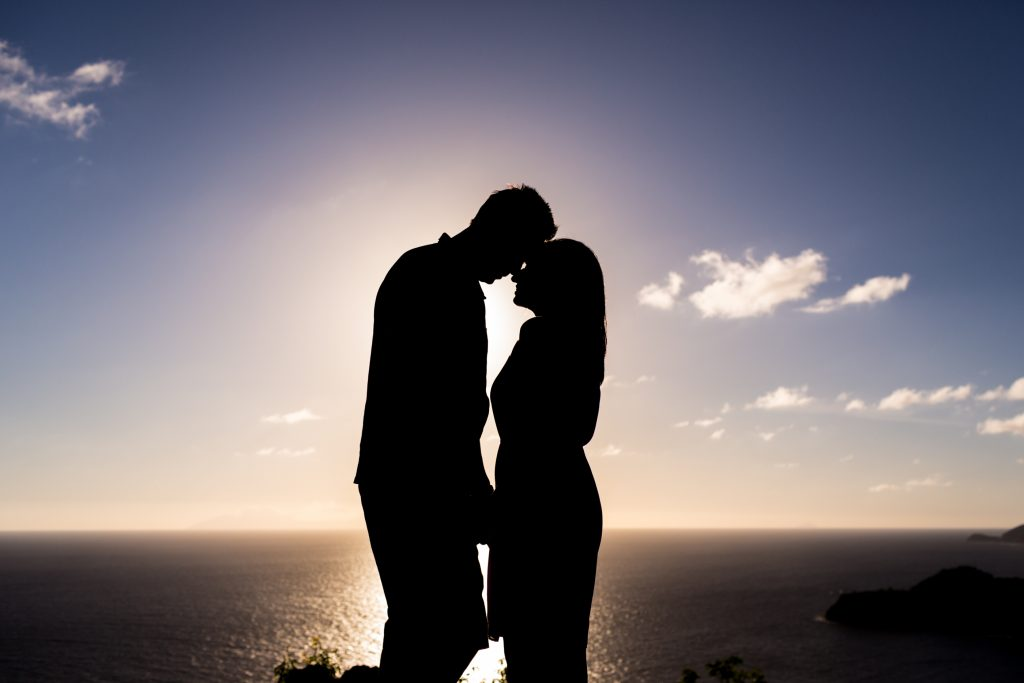 Sunset silhouette portrait of the bride and groom from the top of Antigua's Shirley Heights