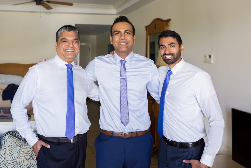 Formal portrait of the groom and his two best men before heading to the outdoor destination wedding ceremony