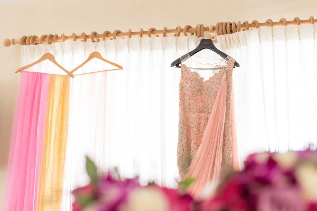 Traditional Indian outfits hanging in the villa waiting for the bride to get ready for her wedding ceremony