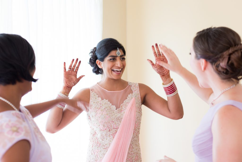 Bride celebrating with her bridesmaids before the wedding ceremony