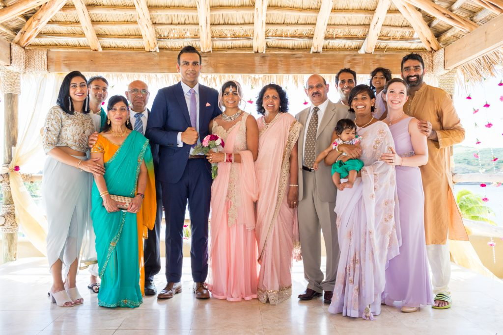 Destination wedding family portrait which includes both the bride and grooms entire immediate family