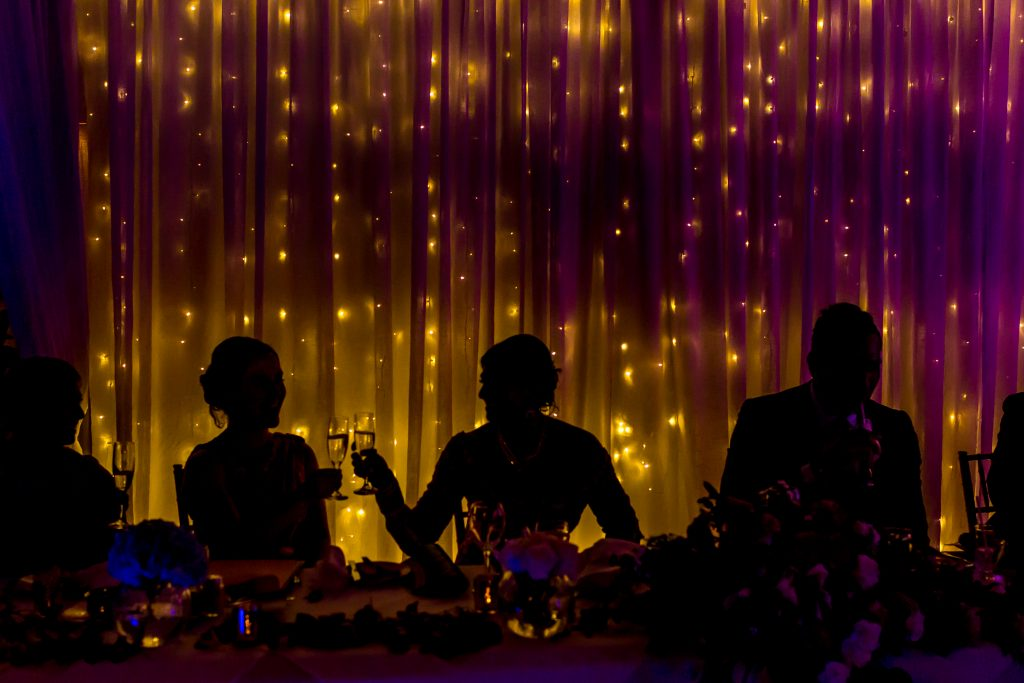 Creative destination wedding reception photo of the bride toasting with champagne glass