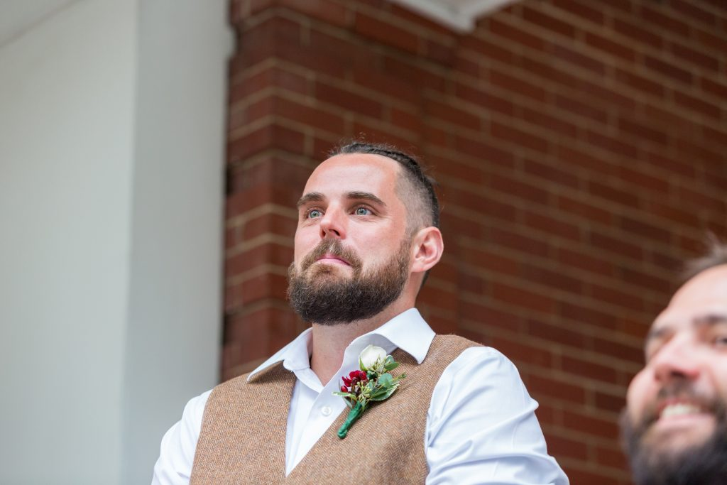 Grooms first look at bride during outdoor wedding ceremony magrath mansion