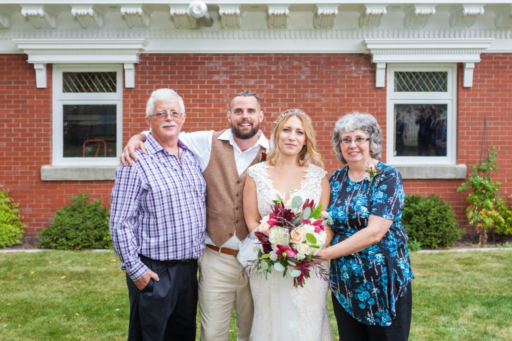 Grooms family portrait at wedding