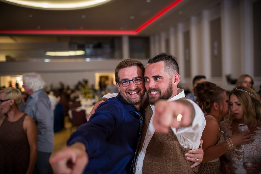 Groom hanging out with guests during wedding dance