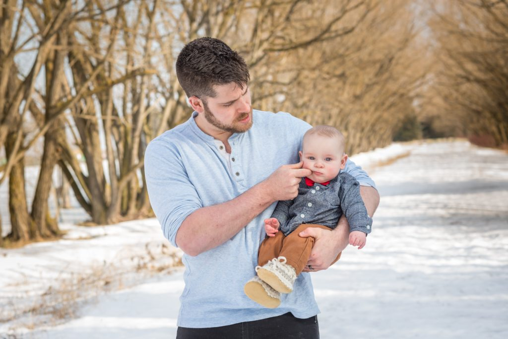 father and son during outdoor winter family photos