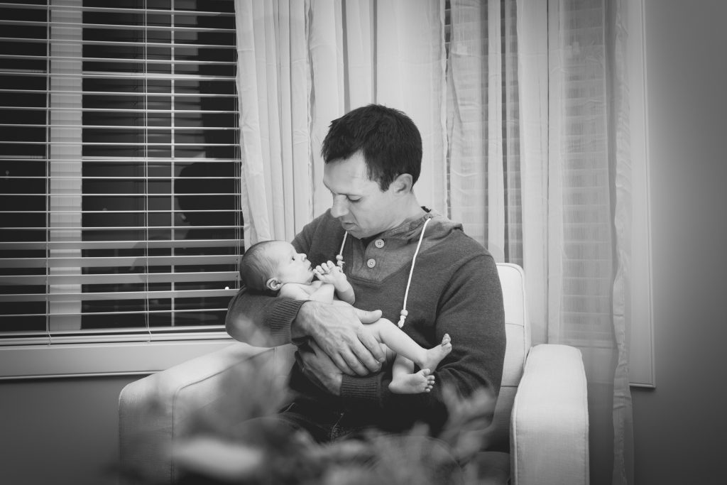 Newborn Family Portraits of father and son