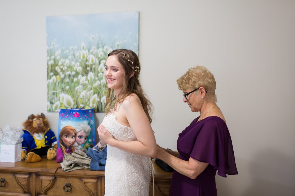 Mother of the bride helping her daughter get ready