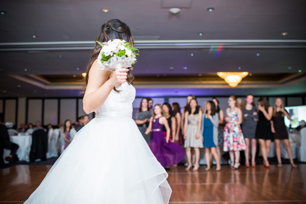 bride preparing to toss the bouquet