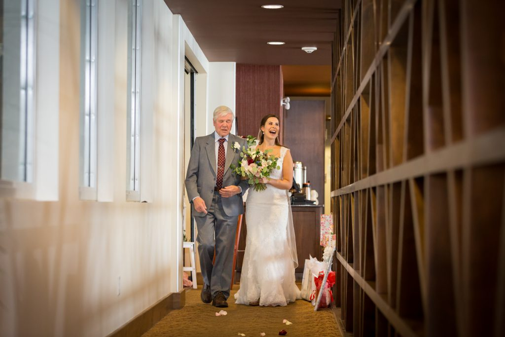 bride and her father before ceremony
