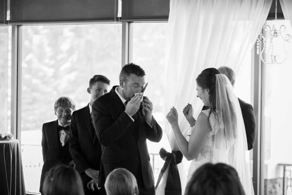 groom crying during wedding ceremony