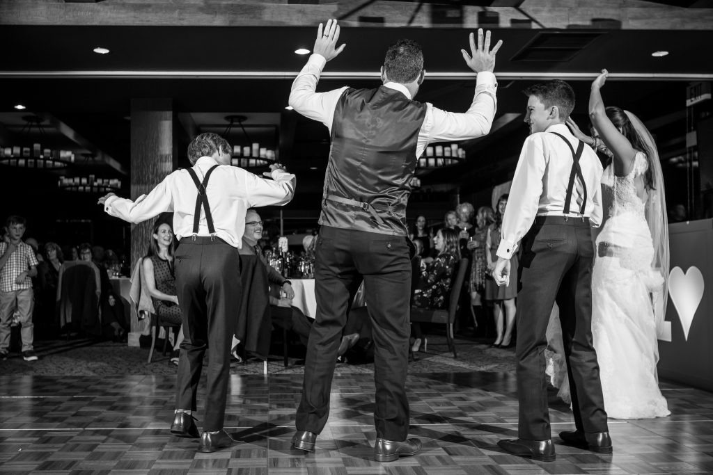 father and sons dancing together