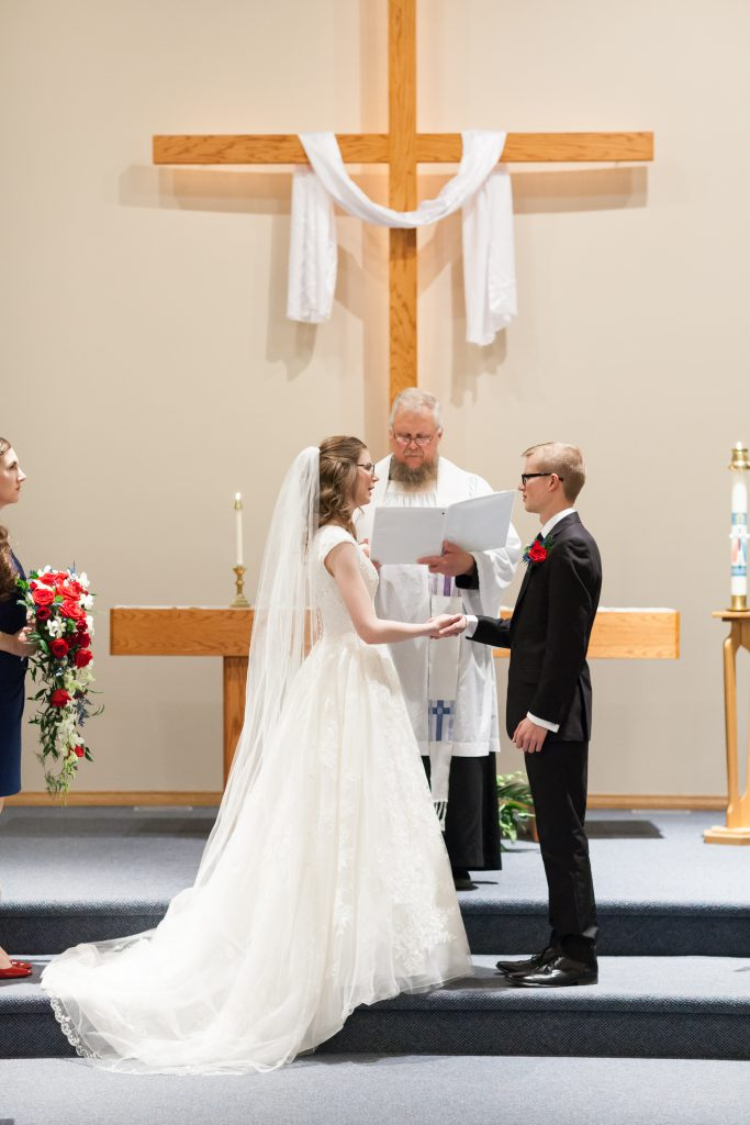 Photo of bride and groom exchanging vows