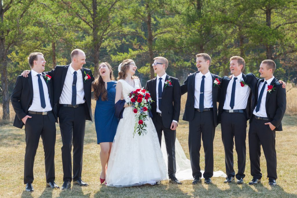 photo of bride and groom with wedding party