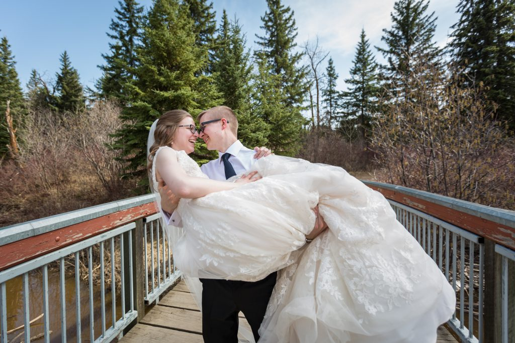 photo of groom carrying the bride