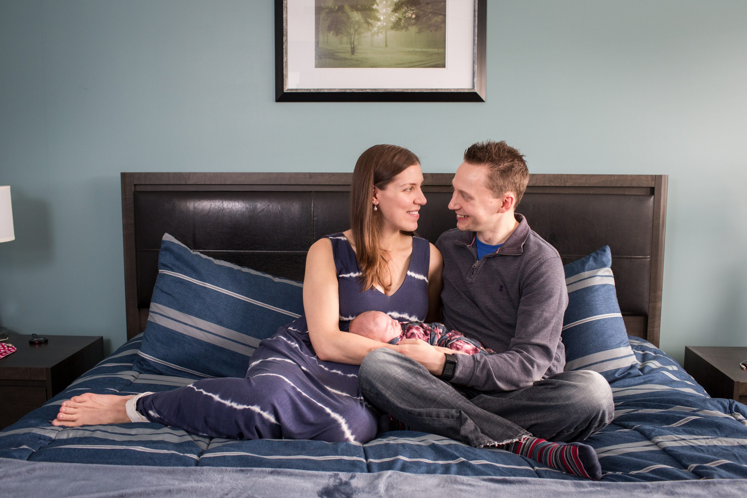 newborn photos taken with the parents at home