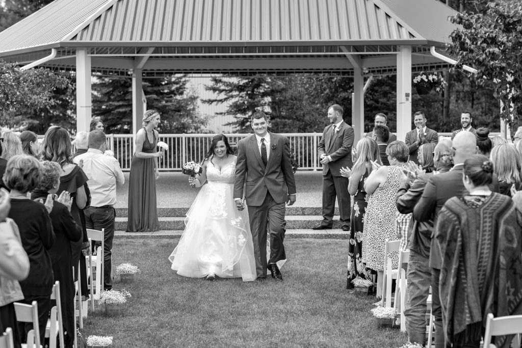 bride and groom walking out of ceremony