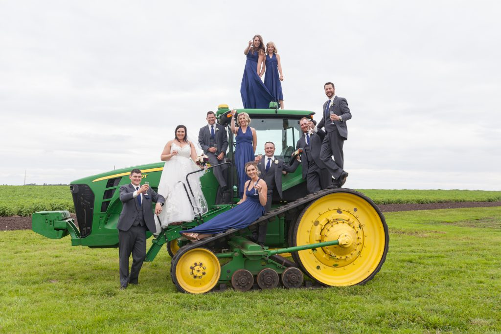 wedding party photo with tractor